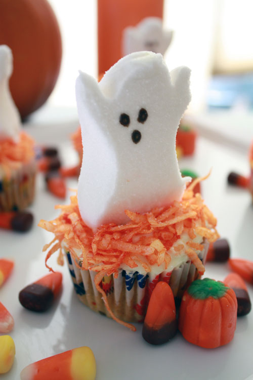 Pumpkin Cupcakes Topped with Coconut Flakes and Peep Ghosts