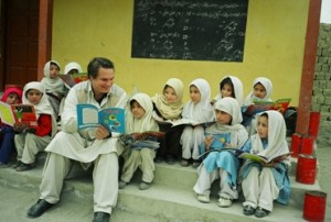 Image from Three Cups of Tea, Greg reading to school children